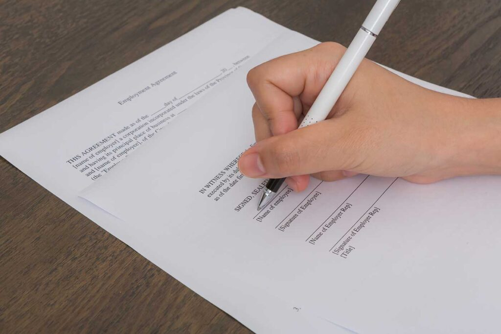 hand writing paper with pen