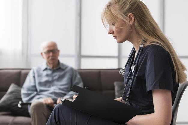 nurse consulting old man nursing home 23 2148740040