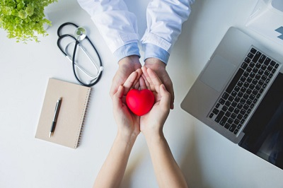 top view doctor patient hands holding red heart white table 38391 541